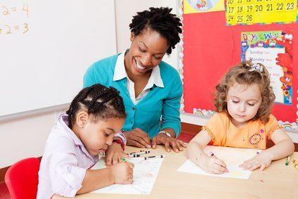 Teacher and girls in art class